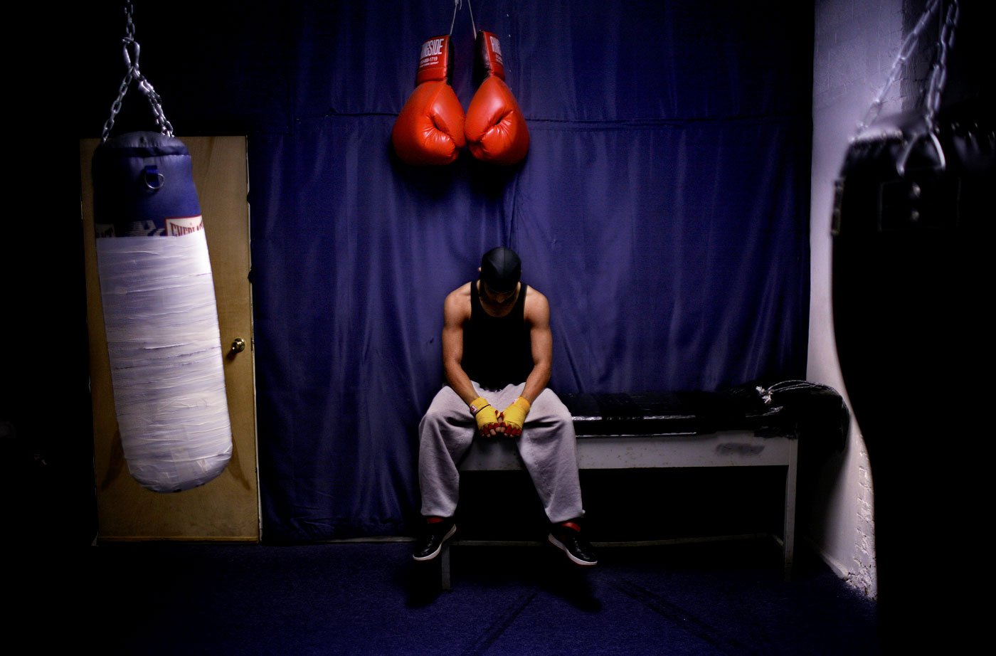 Victor Maldonado, 19, rests while working out at the San Juan Center Sports in Hartford.  Maldonado is from Hartford and works out in the afternoon, when the center has a program for area youth. The center provides an alternative for youth other than hitting the streets in the afternoon.
