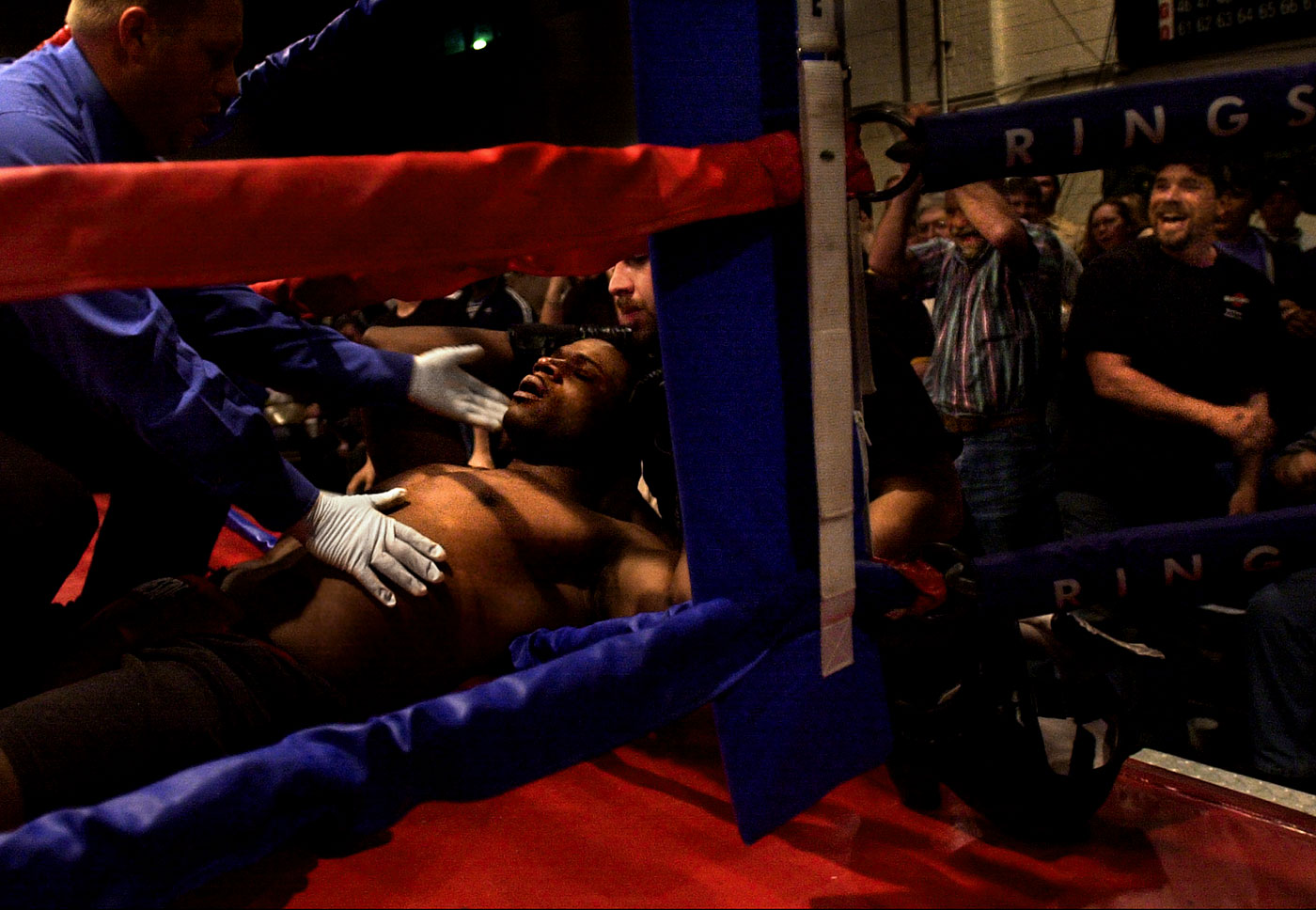 Fans react after Vincent Coleman was knocked out during his fight. At left is the referee, Donnie Jessup.