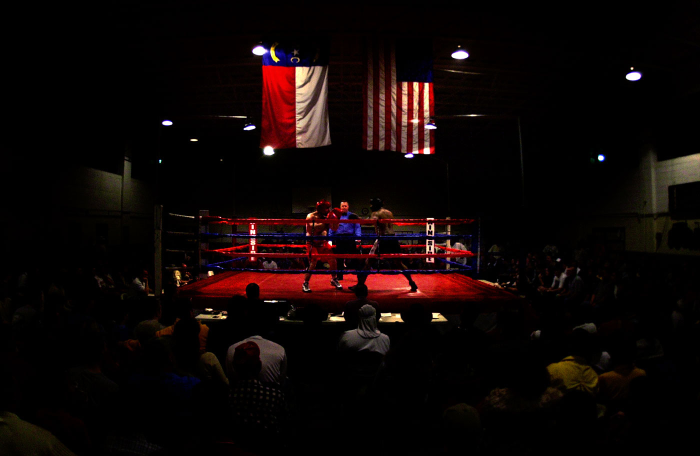 A pair of fighters begin their fight before a capacity crowd.