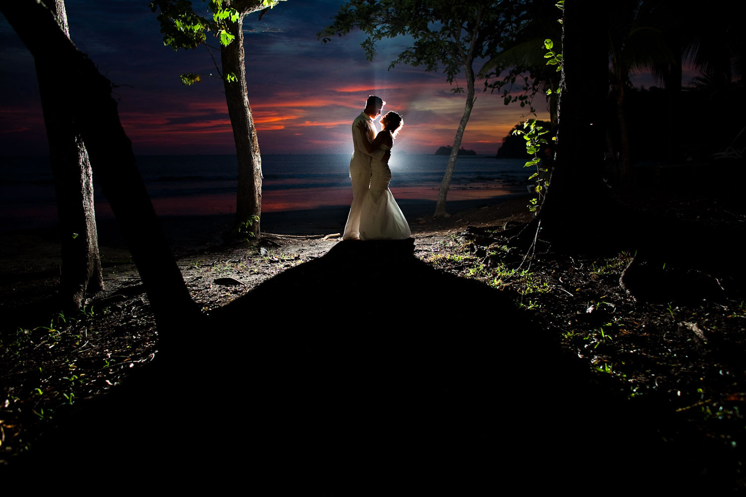 A portrait of a bride and groom at their wedding on Sugar Beach in Costa Rica.
