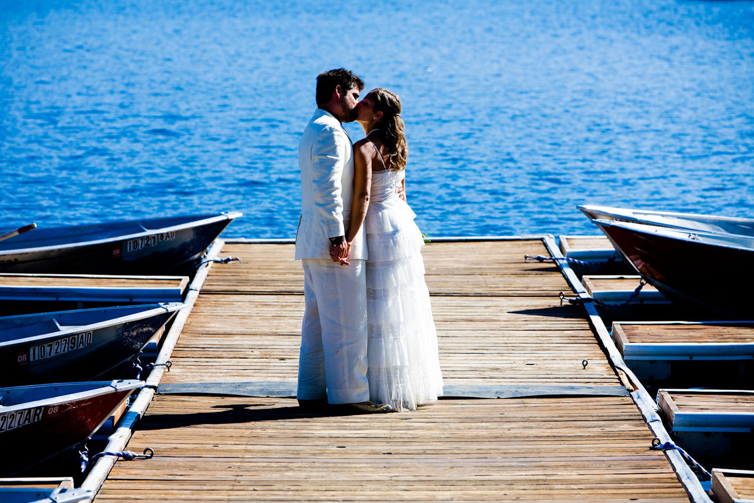 A portrait of a bride and groom kissing on the docks at Redfish Lake Lodge in Stanley, Idaho.