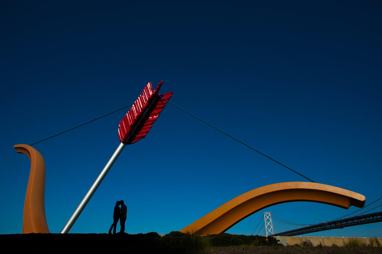 An engagement photograph of a newly engaged couple under Cupid's Span in San Francisco, California.