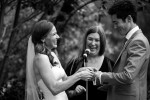A bride humorously struggles to put her groom's wedding band on his ring finger during their wedding reception at Croney Cove out Warm Springs in Ketchum, Idaho.