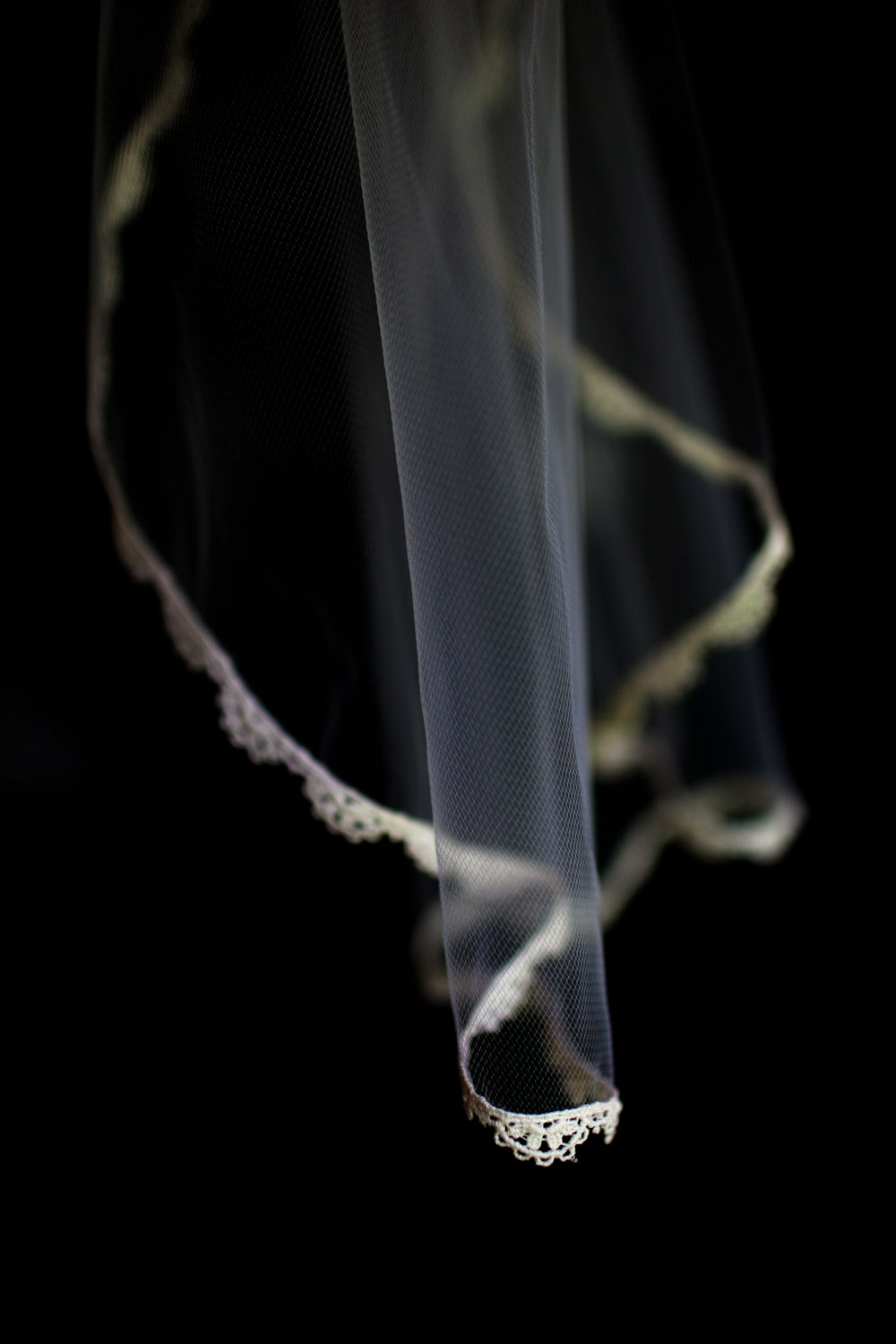 A detail photograph of a bride's wedding veil.