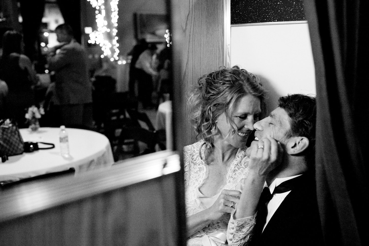 The Bride and Groom enjoy a moment in a photobooth inside the Linen Building, Boise, Idaho.
