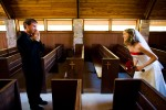 A wedding image of the first moment a groom sees his bride in a church near Ketchum, Idaho.