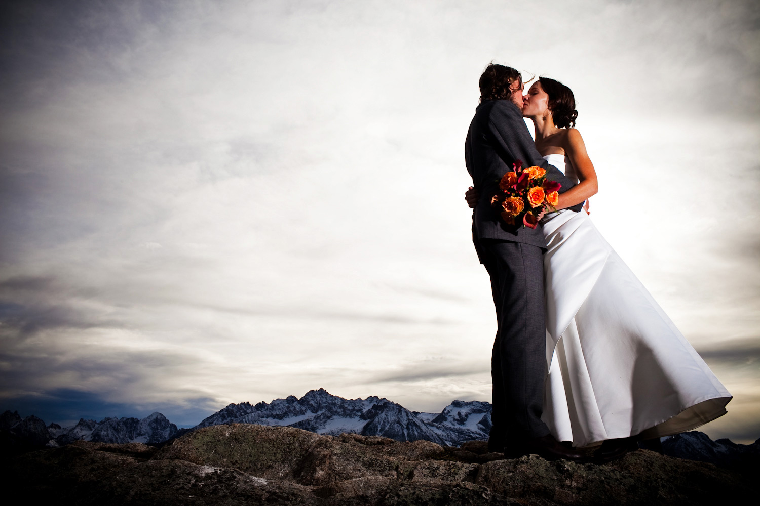 An off camera strobe lit wedding portrait of a bride and groom while atop a mountain near Stanley, Idaho.