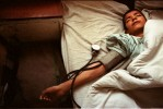 A boy lays unconscious in Kabul's main hospital.©Thomas James Hurst