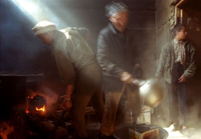 Cooks in Kabul's orphanage stoke the fires and boil water so that they can finish preparing lunch for the more than 700 children the institution cares for.©Thomas James Hurst
