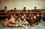 In a Kabul orphanage, young orphans are gathered together for a photograph. The orphanage works to feed, educate, and teach trades or crafts to the more than 700 children they care for.©Thomas James Hurst