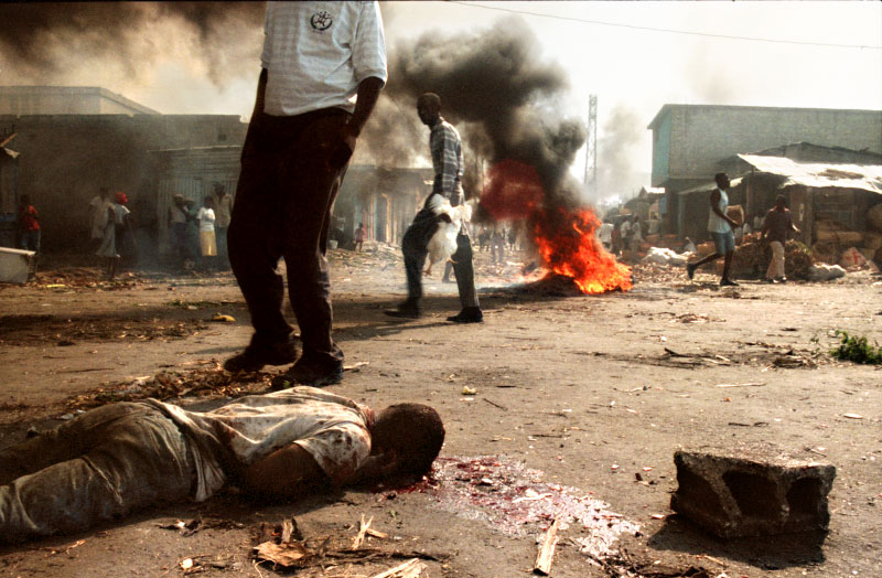 A man lays bludgeoned to death in Port-au-Prince after a mob took to the streets looking to avenge the death of a beloved community leader.©Thomas James Hurst