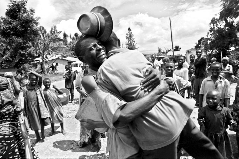 A father and son reunite in the Rwandan village they had lived in before fleeing to Zaire in 1994.  Separated amid the chaos of their escape, each believed the other had been killed two years earlier.©Thomas James Hurst