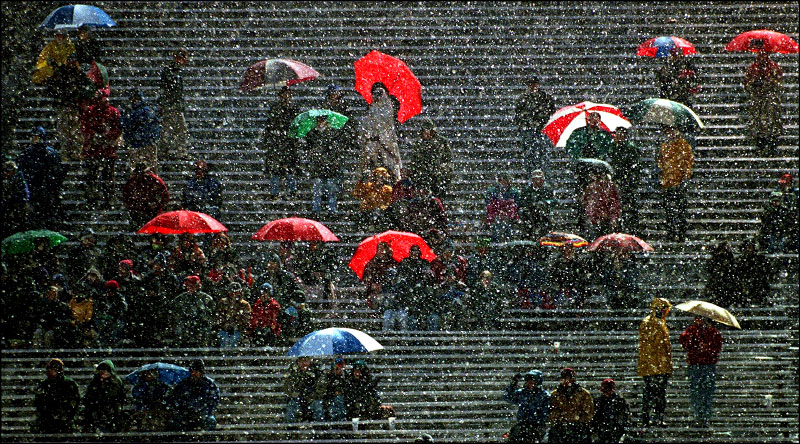 Fans brave the snow at Boston University Stadium to watch the Division 2 girls state soccer championship.©Thomas James Hurst/The Boston Globe