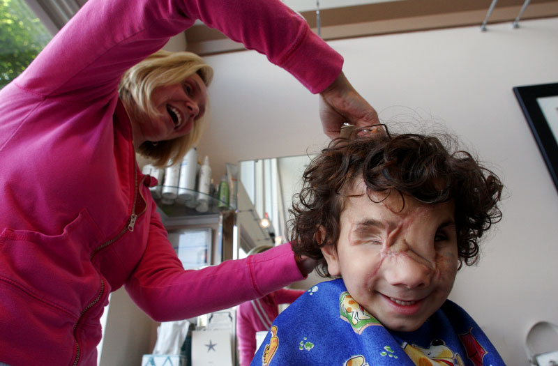 Hair stylist Adrienne Vandall gives Muhammed his first haircut since his arrival in the U.S.