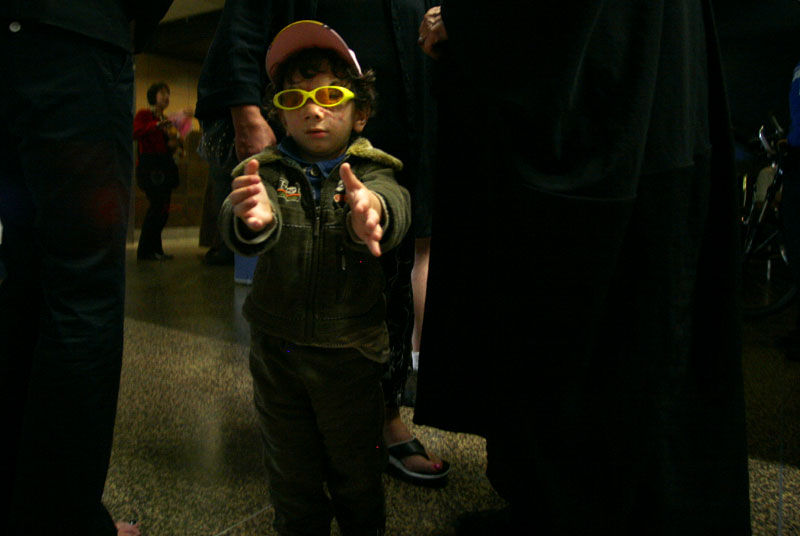 Three-year-old Muhammed Hussein, blind from being shot in the face in his home country of Iraq, extends his arms searching for his grandmother after their long journey from Baghdad to Seattle-Tacoma International Airport.