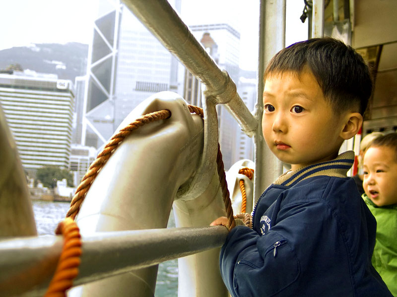 boy on the Star FerryVictoria Harbor, Hong Kong