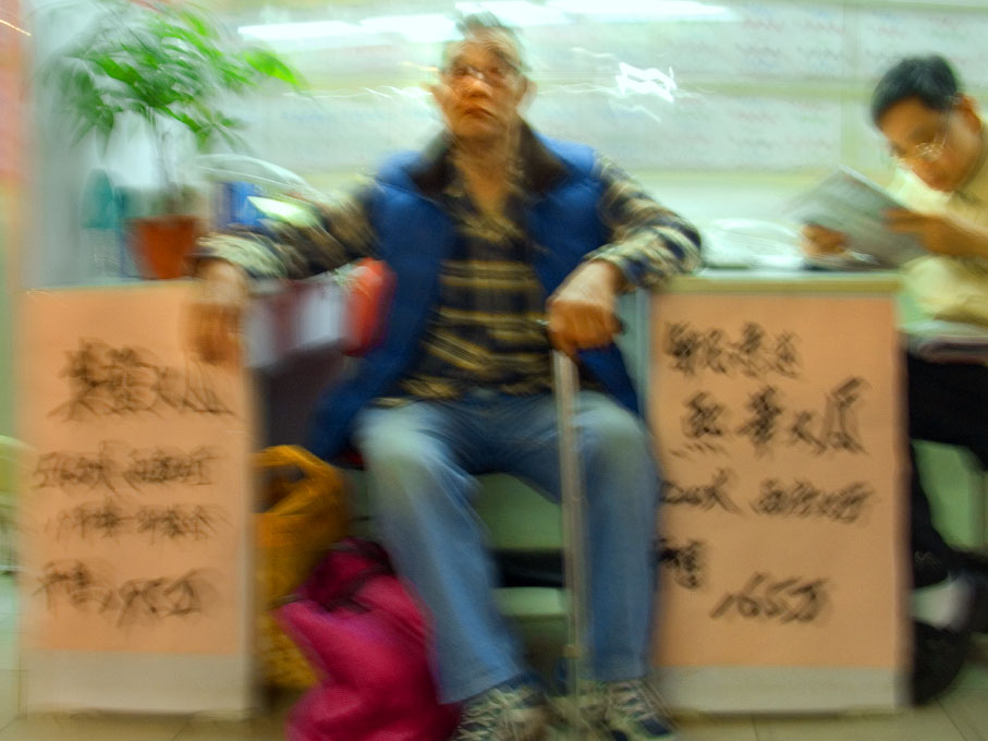 man at an eye doctor's stallHong Kong