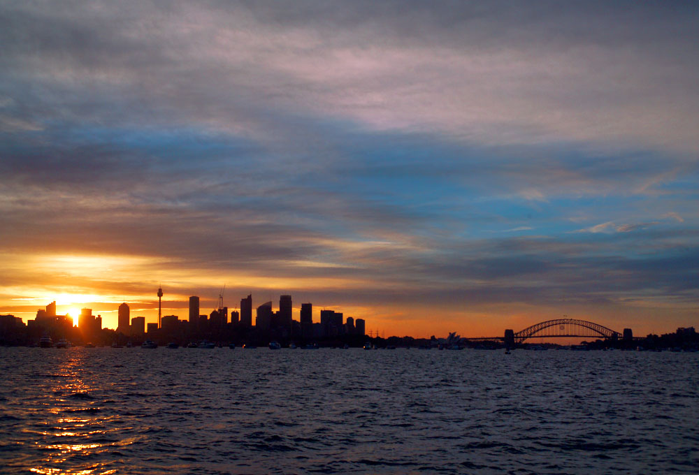 sunset view of downtownand the Harbor BridgeSydney, Australia