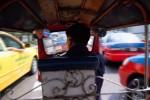 tuk-tuk driver navigating heavy trafficBangkok, Thailand