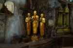 three gilt Buddhas in a garden Wat Sa KetBangkok, Thailand