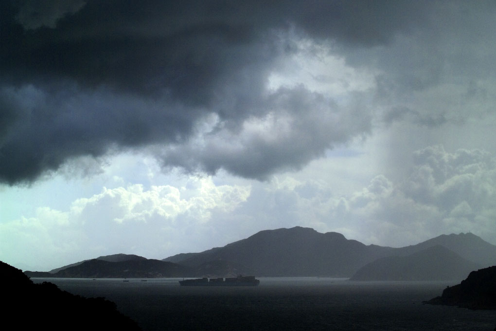 freighter in East Lama Channel during thundershowerHong Kong