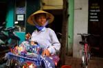 saleswoman hawking waresOld Quarter - Hanoi, Vietnam