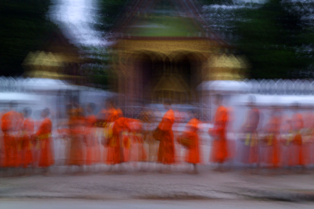 monks collecting evening offeringsLuang Prabang, Laos