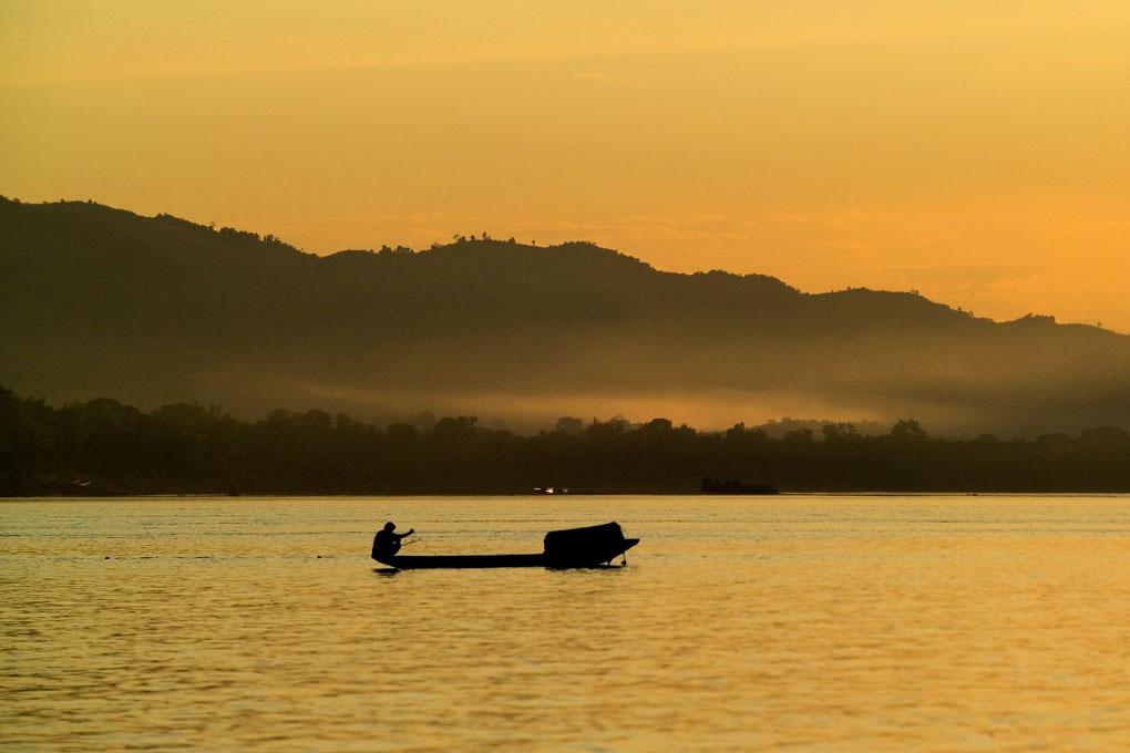 fisherman out at duskMekong River - Laos