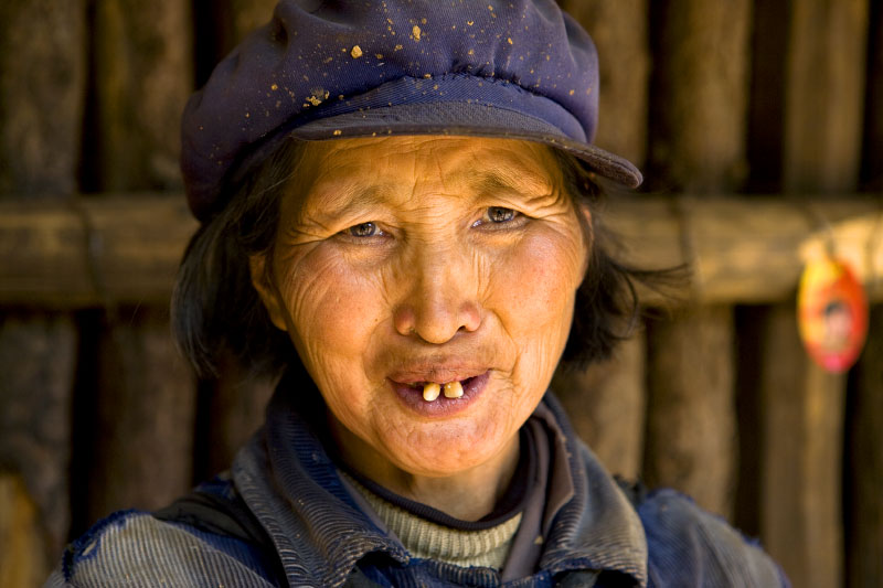 villager outside her homeWenhai ValleyYunnan province, China