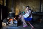 cook warming at fire in Wenhai VillageYunnan Province, China