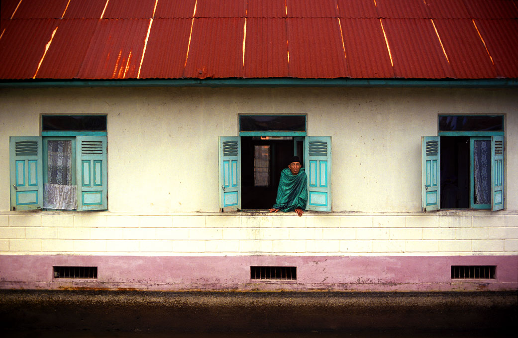 muslim villager in window of his home near Padang Panjang, West SumatraIndonesia