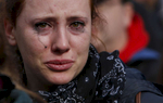 Boston, Massachusetts -- 11/15/2015- Marine Gazan, an au pair from France cries during a rally held on the Boston Common in response to the Paris attacks in Boston, Massachusetts November 15, 2015.