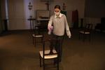 East Boston, MA - 4/29/20 - Apprentice funeral director Catie Ruggiero, sprays each chair down with lysol following a wake at Ruggiero Family Memorial Home in East Boston as funeral homes cope with a coronavirus or COVID-19 surge. (Jessica Rinaldi/Globe Staff)