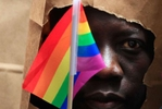 <p>An asylum seeker from Uganda covers his face with a paper bag in order to protect his identity as he marches with the LGBT Asylum Support Task Force during the Gay Pride Parade in Boston, Massachusetts June 8, 2013. Homosexuality in Uganda is illegal and carries a potential penalty of life in prison.</p>