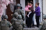 <p>SWAT teams conduct a house to house search as they look for the remaining suspect in the Boston Marathon bombings in Watertown, Massachusetts April 19, 2013. </p>