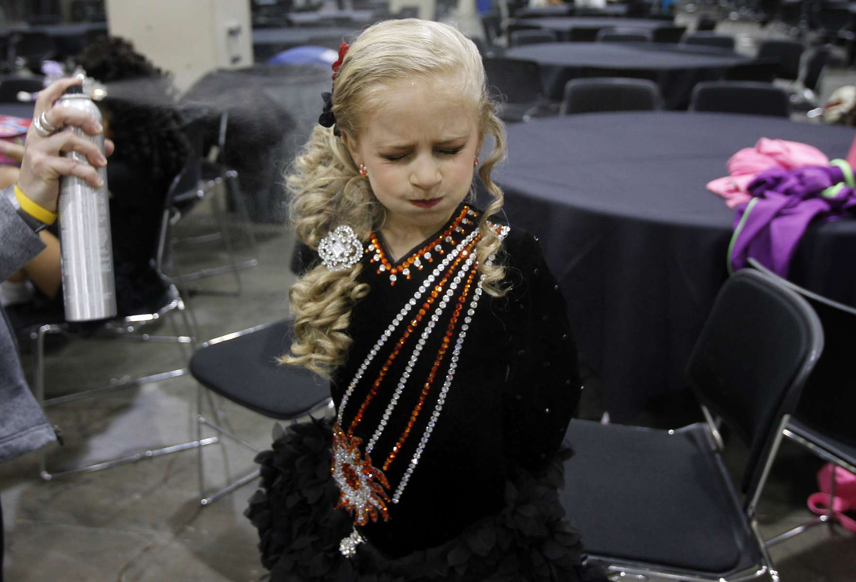 Simone Loysen, 10, holds her breath as her hair is sprayed backstage at the World Irish Dancing Championships in Boston, Massachusetts March 24, 2013.