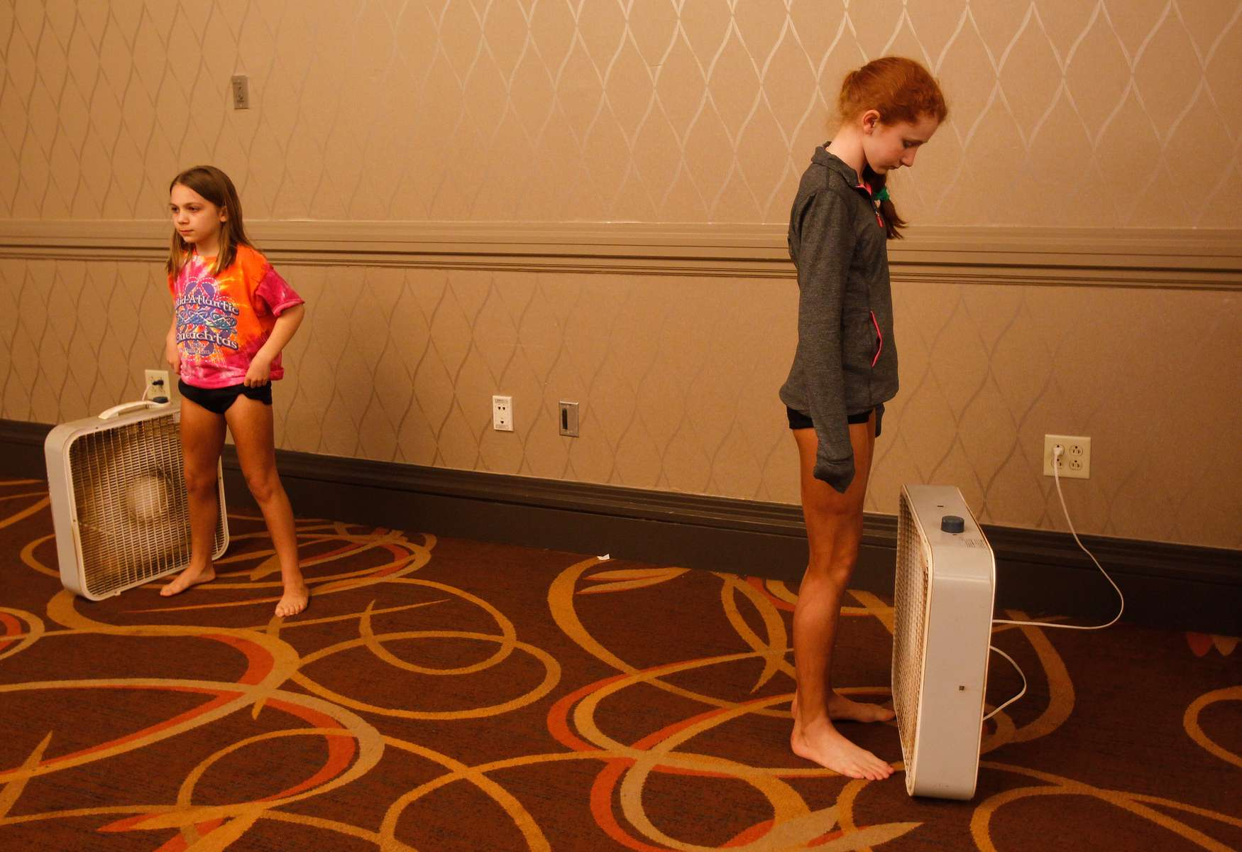 <p>Girls competing in the World Irish Dancing Championships stand next to fans as they wait for their spray tans to dry in Boston, Massachusetts March 24, 2013.</p>