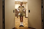 Katie Coites, 12, of England watches from back stage as she waits to compete in the World Irish Dancing Championships in Boston, Massachusetts March 24, 2013.