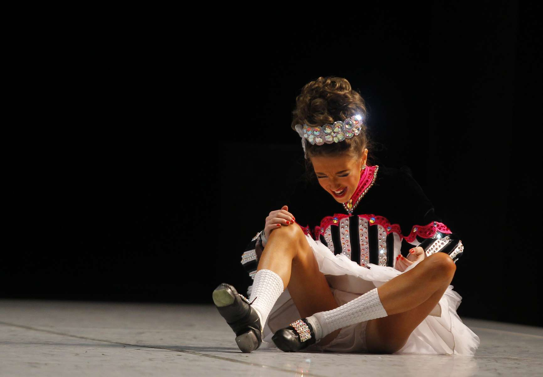 A competitor reacts after falling at the World Irish Dancing Championships in Boston, Massachusetts March 24, 2013.