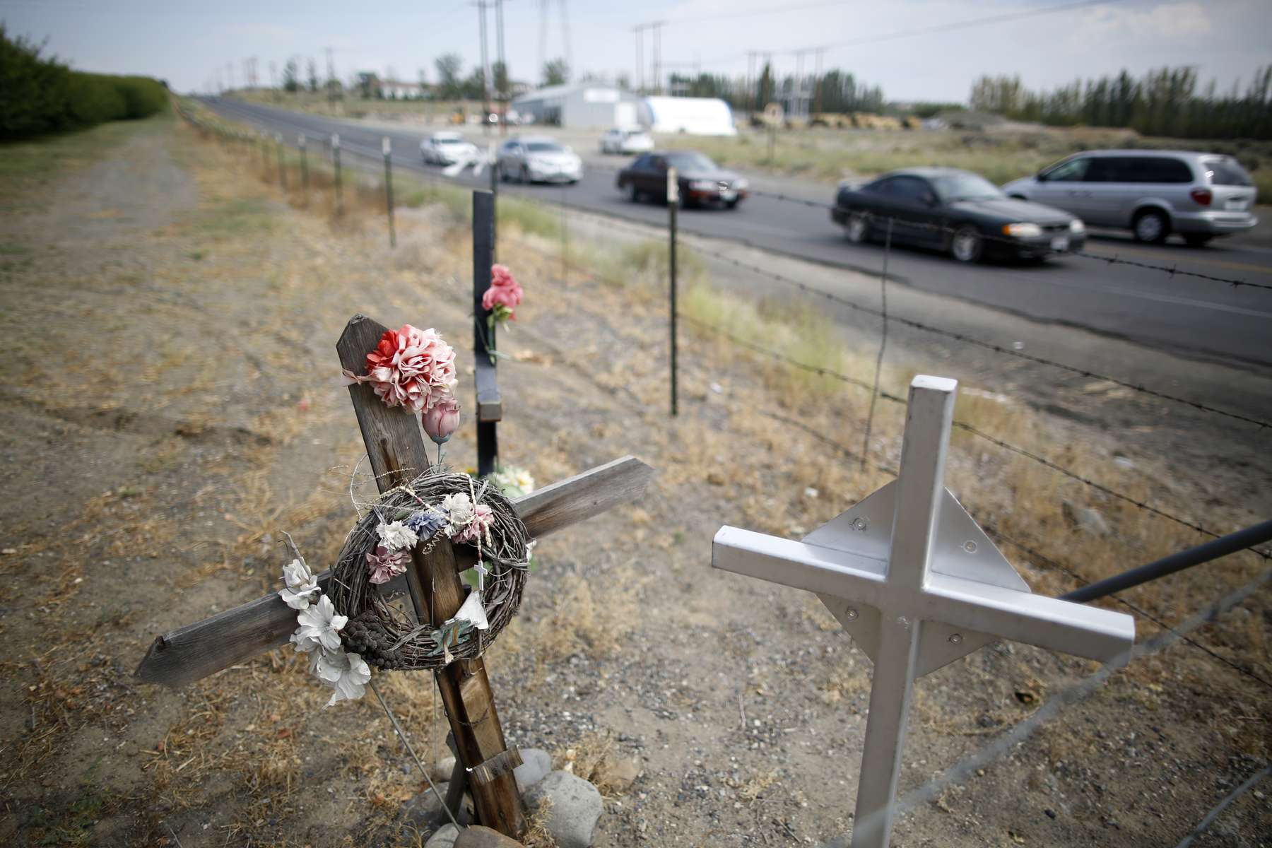 Crosses honoring people who have been killed at the intersection of two major roads are seen in Mattawa, Washington August 23, 2013. Traffic violations run rampant in the town where a large percentage of the residents are not US citizens and many do not have drivers licenses or insurance.