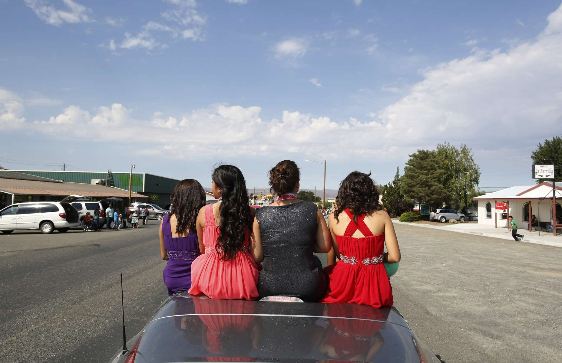 Members of the Distinguished Young Women of Mattawa ride in the Mattawa Community Days parade in Mattawa, Washington August 24, 2013.With few solutions on the horizon in Congress, towns such as Mattawa are left to chart their own futures, amid divisions between workers and bosses, foreigners and Americans.