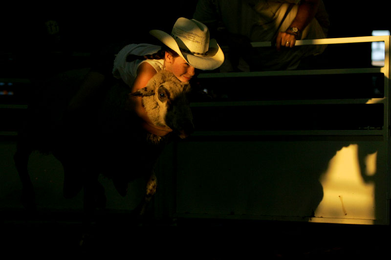 Madison Williams, 8, competes in the mutton busting competition at the Bibles, Broncs, and Bulls Rodeo held at the Cowboy Church in Waxahachie,Texas September 29, 2007.