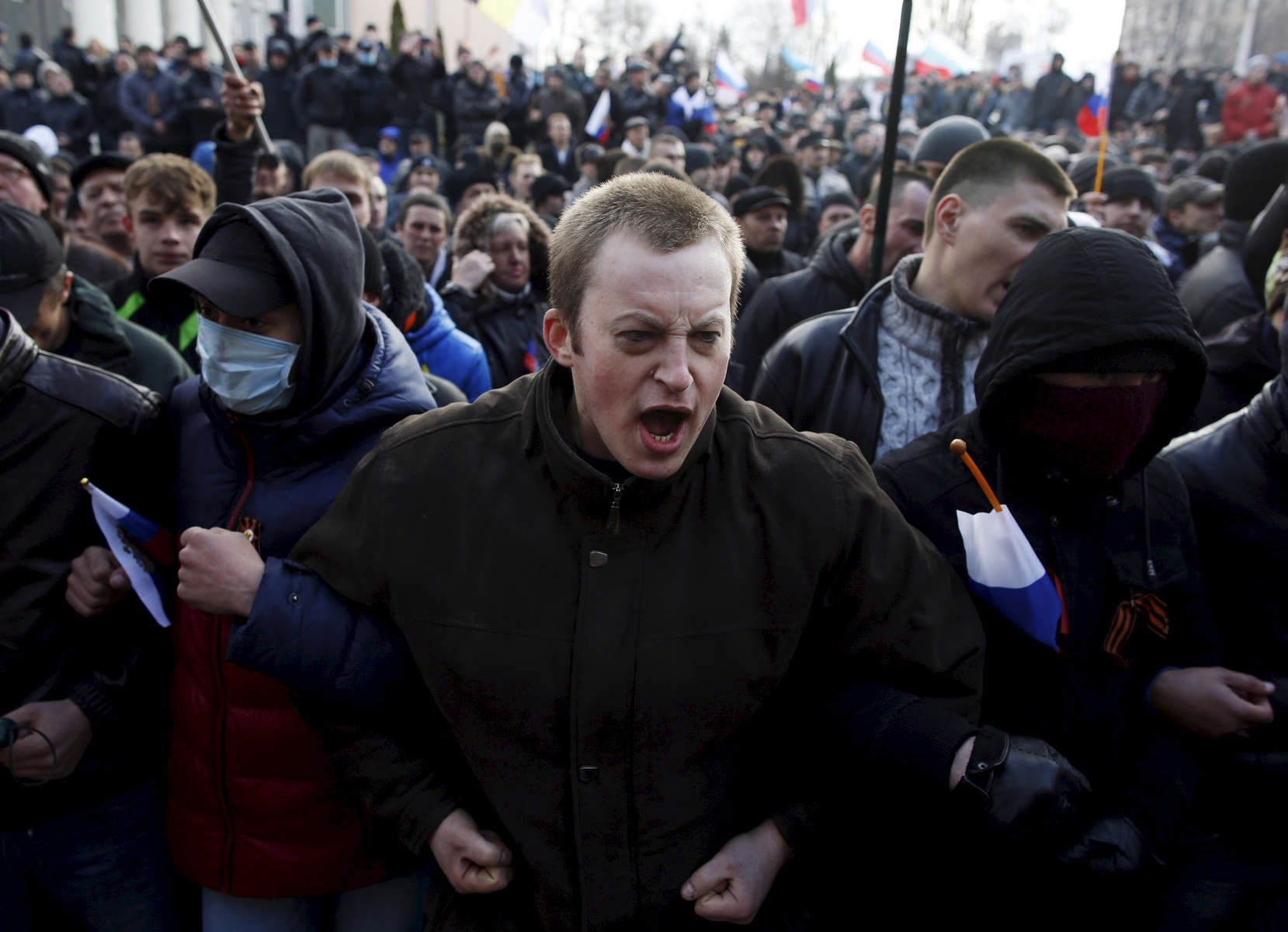 Donetsk, Ukraine-- 03/16/2014-- Pro-Russian protesters chant outside of the Donetsk Prosecutors Building before storming into the building during a protest in Donetsk, Ukraine March 15, 2014.