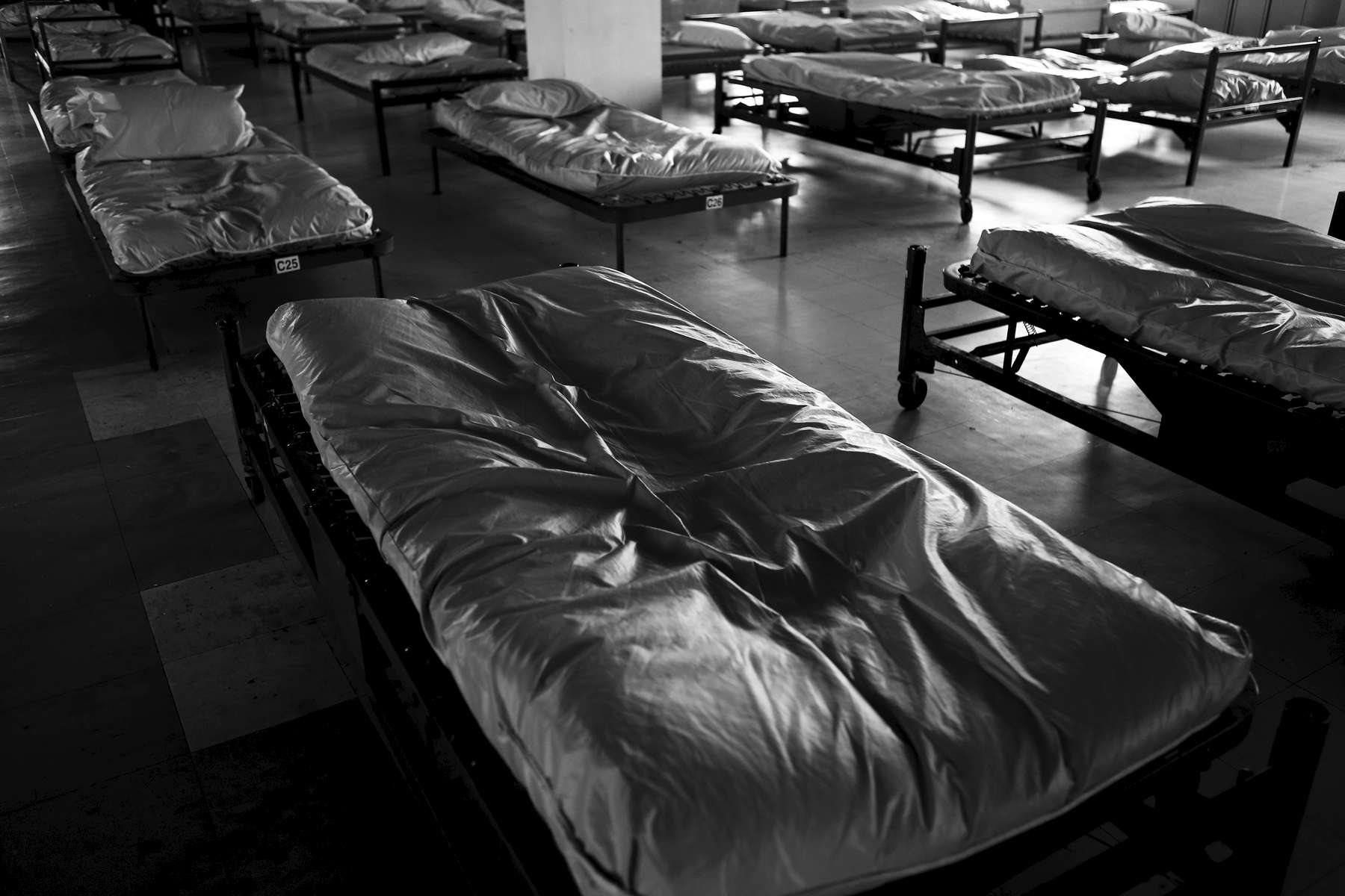 Boston, Massachusetts -- 10/21/2014-- An impression of a body is all that remains on a bed inside the men\'s shelter after the Long Island shelter on Long Island was abruptly evacuated.
