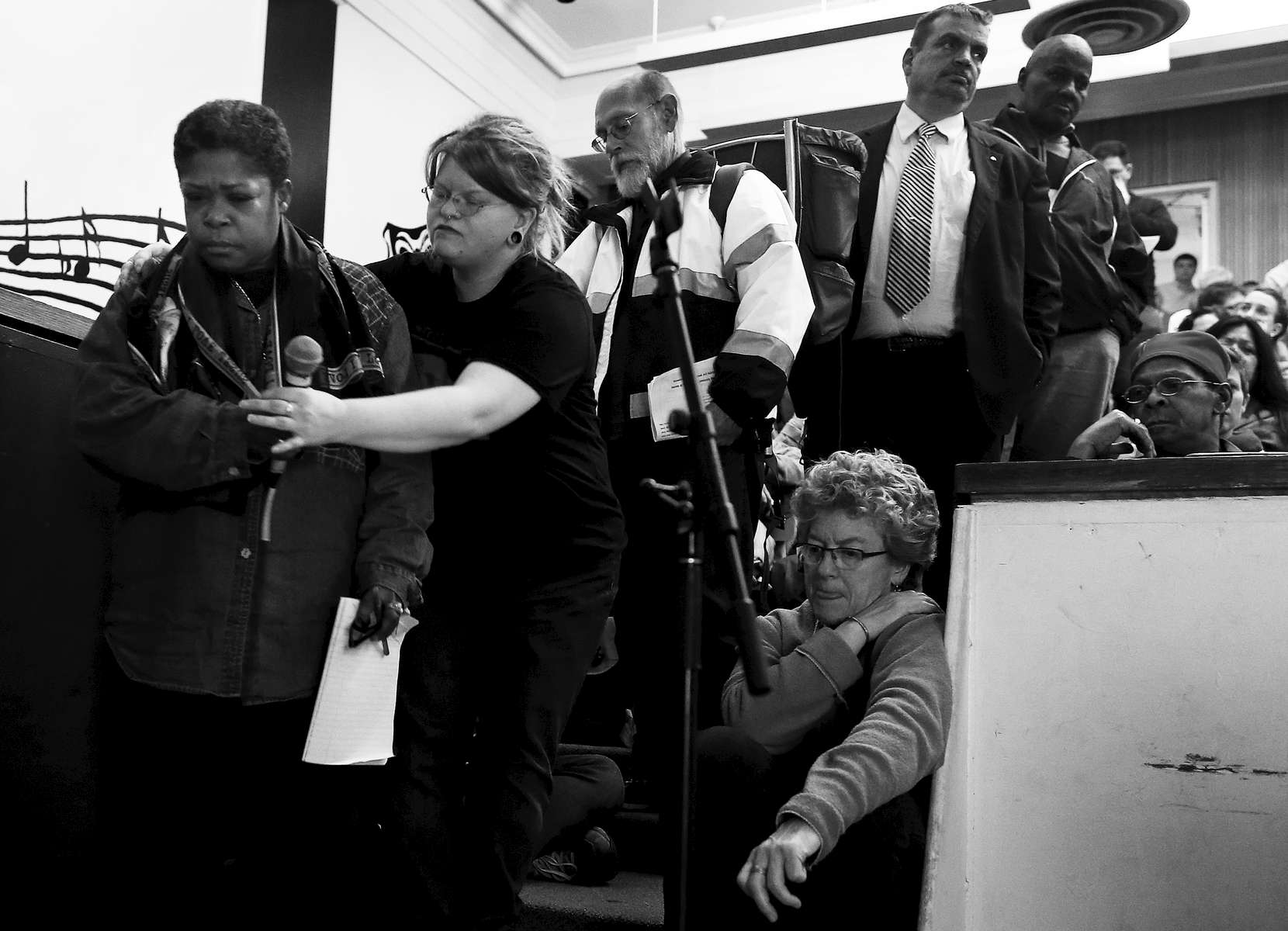 Boston, Massachusetts -- 11/12//2014-- When the floor was opened at a community meeting with city officials Lisa Marie Jenkins was the first to speak. She told the city officials gathered there how the lack of beds in shelters for women have led her to have to sleep outside.  She described weathering the cold nights in many layers underneath a plastic tarp scared she might get hypothermia.