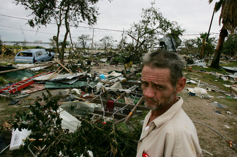 Christopher Cox stands amid debris caused by Hurricane Ike in the trailer park where he lived before his home was destroyed in Galveston, Texas September 14, 2008.