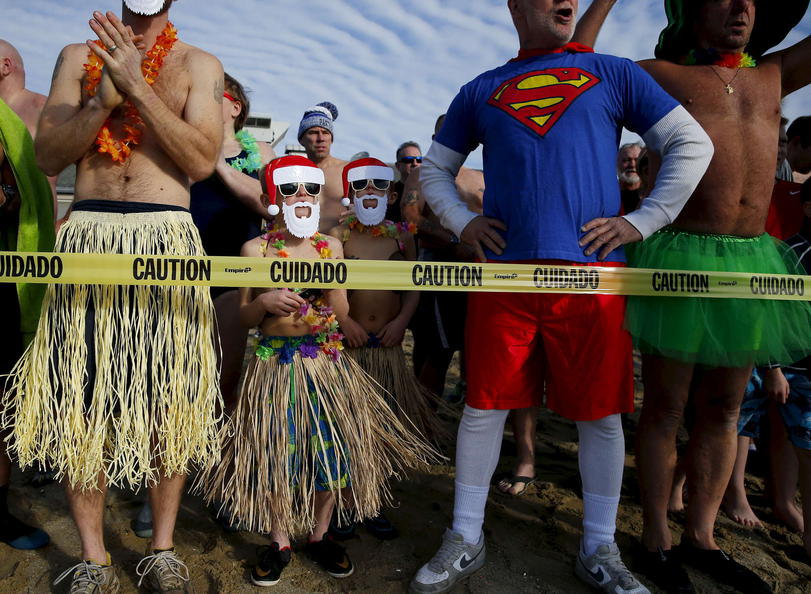 South Boston, MA -- 1/1/2017 - Jack Richard, 8, (2nd from L) and Jack Schaefer, 8, of Salem, NH both dressed in hula skirts as they waited for the start of  the L Street Brownies annual New Year's Day polar plunge into Dorchester Bay.