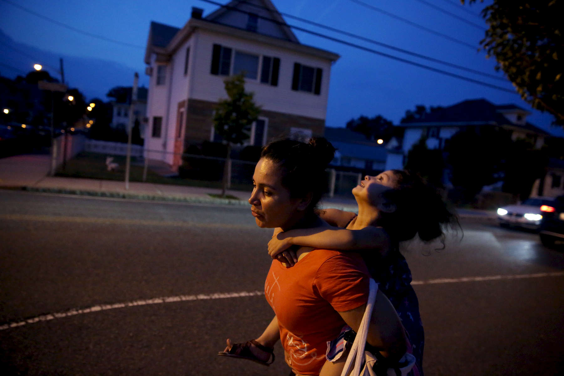 Revere, MA--7/27/2018--  As the end of the day draws near Patricia carries Camila up the street that leads from the park back to their apartment. A single mother who works full time almost all of her free time is devoted to her daughter. She wonders what might happen if she were deported? What would their life look like in Honduras? Where would they live and what would she do for a job?