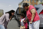 Revere, MA -- 5/3/2018 - Patricia bent down to say goodbye to her daughter, Camila, as she dropped her off with her Godmother's mom, Tete, before a meeting with her immigration lawyer. Fearful that the Trump administration might repeal her Temporary Protected Status Patricia has started to make plans for her daughter, Camila, 4, who is a US citizen. If her TPS was repealed and Patricia were to be unexpectedly picked up and deported, Camila would stay with Tete, one of the few trusted friends that Patricia has who has US citizenship.