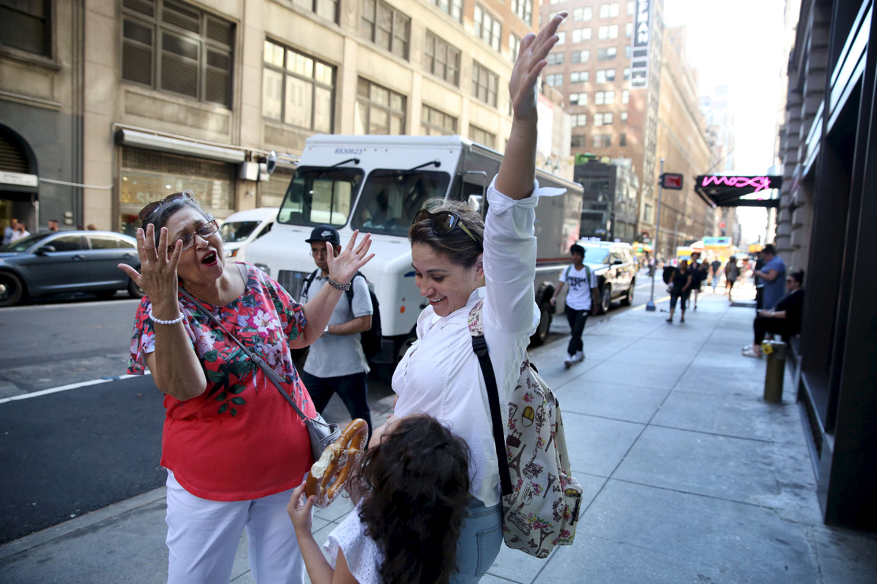 New York, NY--7/20/2018--  Tete started singing Frank Sinatra's 'New York, New York' and she and Patricia threw their arms in the air for Camila as they got to the finale. They had come to New York to renew Patricia's passport at the Honduran Consulate, which took hours but Patricia was determined to show Camila Times Square and give her a taste of the Big Apple before they left.
